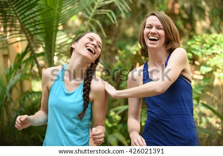 Sisterhood or friendship and laughing while enjoying the moment - stock photo