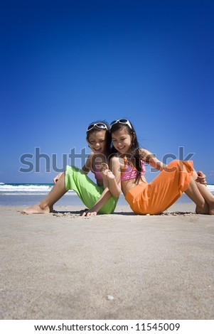Sisters at the beach - stock photo