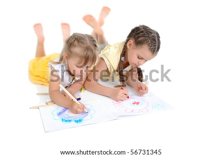 sisters draw on the album. Isolated on white background - stock photo