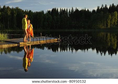 Sisters enjoy the summer sunset - stock photo