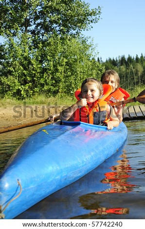 Sisters in kayak - stock photo