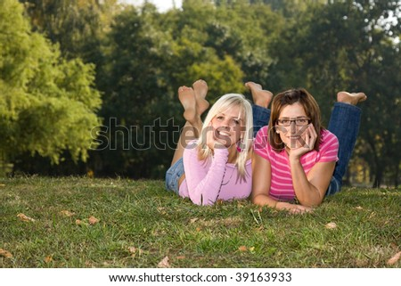 sisters laying in the park - stock photo