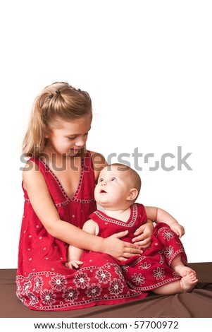 Sisters looking at each other. White background. - stock photo