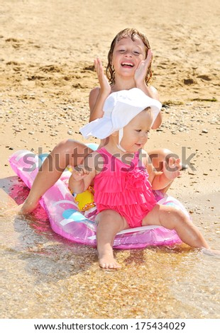 sisters on the sea near the water - stock photo