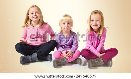 Sisters over ocher background - stock photo