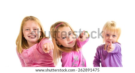Sisters pointing to the front - stock photo
