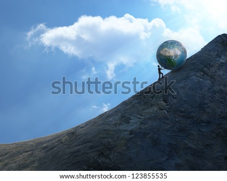 Sisyphus - man pushing a heavy bolder up hill. - stock photo