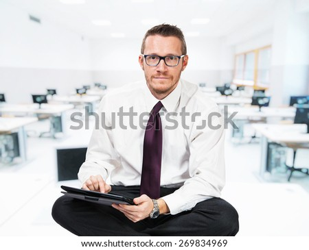 sit businessman with tablet and school background - stock photo