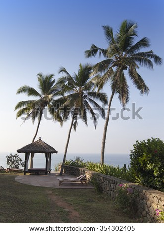 Site for meditations  on the edge of the rock over the ocean, Kerala, India - stock photo