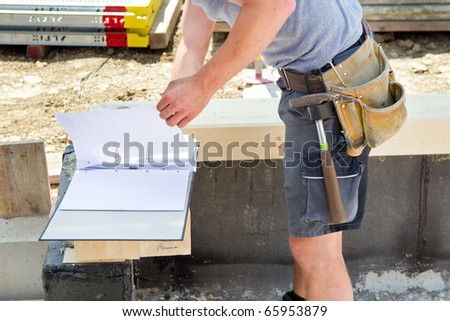 site foreman is looking into some blueprints
