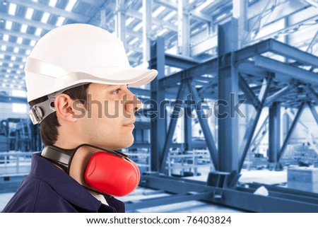 Site manager in an industrial facility - stock photo