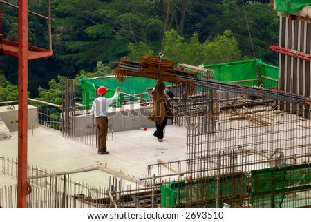 Site manager inspecting at a construction site for high-rise residential apartment block