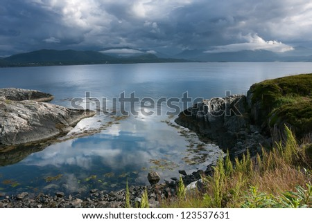 Site of a coastline of an ocean gulf before a bad weather, Norway, the Atlantic road - stock photo