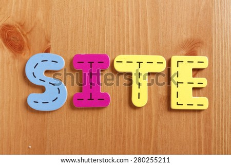 SITE, spell by woody puzzle letters with woody background - stock photo