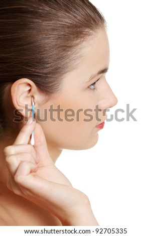 Site view of a face closeup while cleaning up an ear with a swab, over white. - stock photo