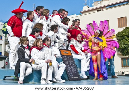 SITGES, ES - FEBRUARY 13: The Carnival's Child Queen at the end of the Bed Race delivering the prize to one of the winners on February 13, 2010 in Sitges, ES.