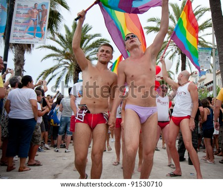 SITGES - JULY 9: Pride of the lesbian, gay, bisexual and transgender People in the streets of Sitges, Spain on July 9, 2011. - stock photo