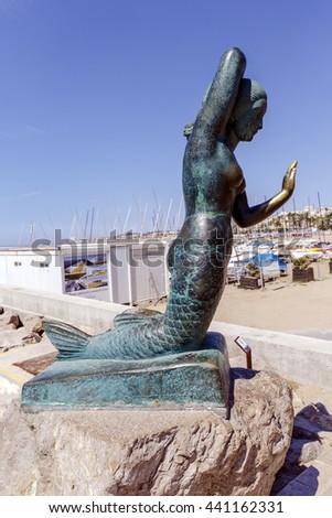 Sitges, Spain - June 7, 2015: Sitges, Spain - June 7, 2015: Mermaid sculpture Pedro Jou built in bronze, turned into emblem of the city - stock photo