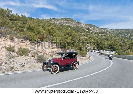 """SITGES, SPAIN - MARCH 11: Jordi Buil drives a 1924 Ford T on the second phase of the """"54th Rally of Ancient Cars Barcelona-Sitges"""" on March 11, 2012 in Sitges, Spain. - stock photo"""