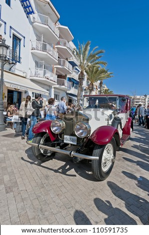"SITGES, SPAIN - MARCH 11: Jordi Ricardo Palau drives a 1924 Silver Ghost ROLLS ROYCE on the second phase of the ""54th Rally of Ancient Cars Barcelona-Sitges"" on March 11, 2012 in Sitges, Spain."