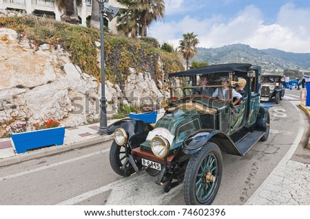 "SITGES, SPAIN - MARCH 27: Josep Rusi���±ol drives a 1918 Renault to Sitges Port for the second phase of the ""53rd Rally of Ancient Cars Barcelona-Sitges"" on March 27, 2011 in Sitges, Spain. - stock photo"