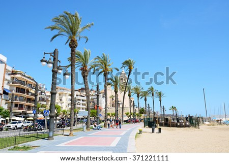 SITGES, SPAIN - MAY 23: The tourists enjoiying their vacation at seafront on May 23, 2015 in Sitges, Spain. Up to 60 mln tourists is expected to visit Spain in year 2015. - stock photo