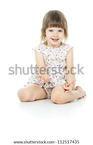 sits a beautiful little girl - stock photo