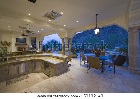 Sitting area by sunken kitchen with view of porch at home - stock photo