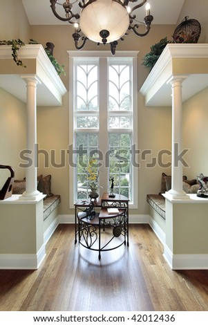 Sitting area in luxury home with two benches - stock photo