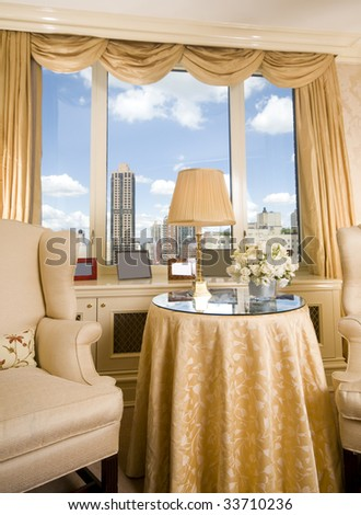sitting area in luxury penthouse bedroom suite with skyline views of new york city - stock photo