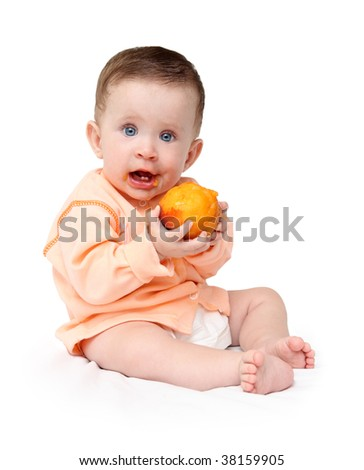 sitting baby eating peach isolated on white