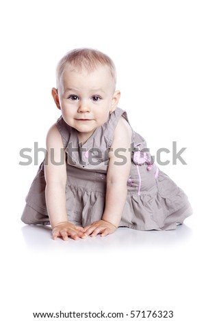 Sitting Baby Girl over white background - stock photo