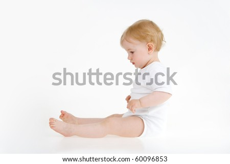 Sitting baby on white background.