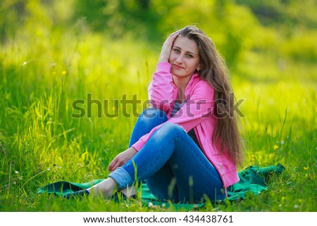 sitting beautiful girl - stock photo