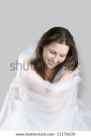 sitting beauty bride in white dress looks down - stock photo