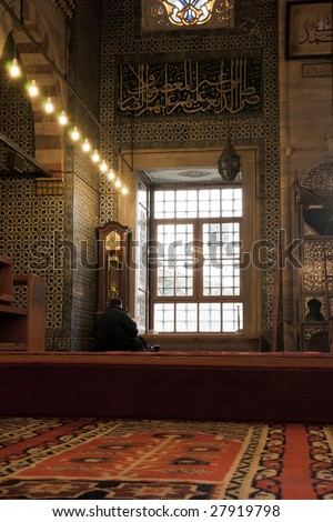 Sitting believer inside a mosque in Istanbul - stock photo