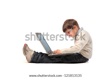 Sitting child using a laptop computer - stock photo