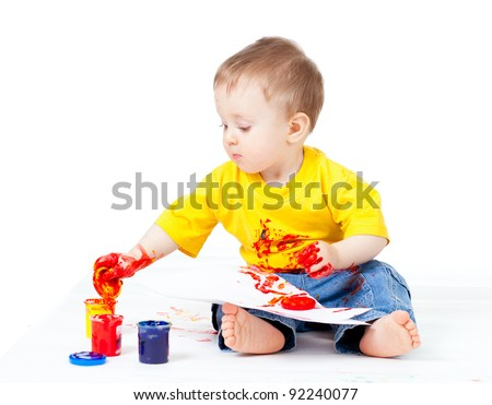 sitting child with color paint - stock photo
