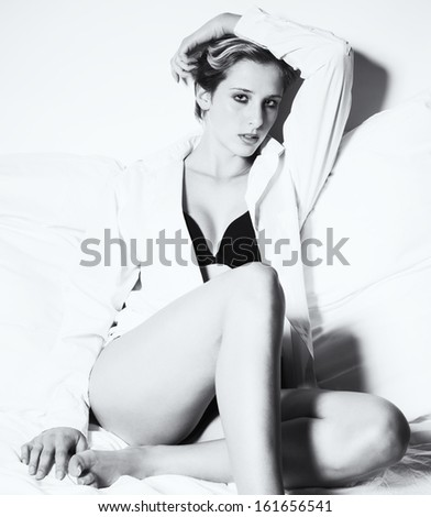 sitting elegant sexy woman in black and white - stock photo