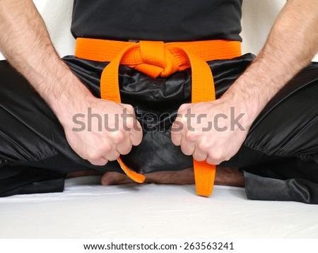 sitting fighter orange belt martial arts  - stock photo