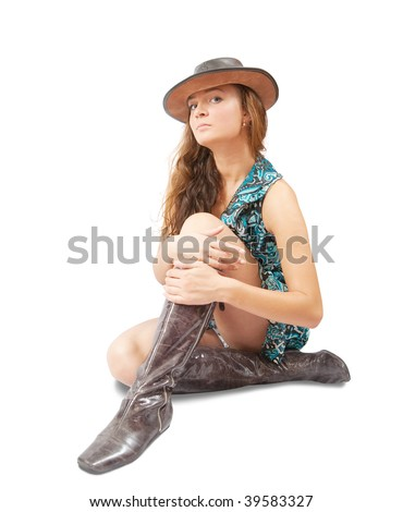 Sitting girl in cowboy hat and high shoes. Isolated on white