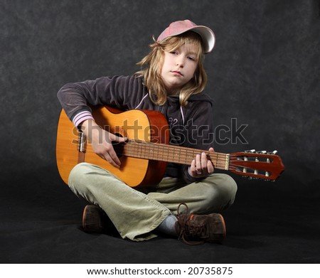 Sitting guitar player - stock photo