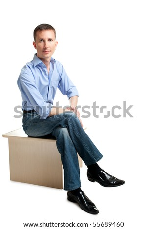 sitting handsome guy over white - stock photo