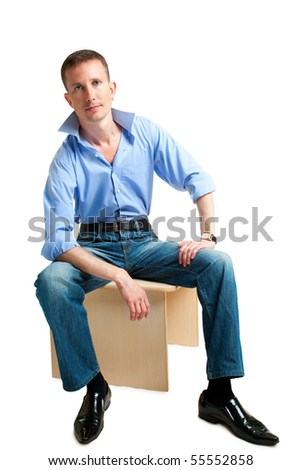 sitting handsome man isolated over white - stock photo