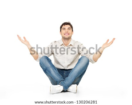 Sitting happy man with raised hands up isolated on white background. - stock photo