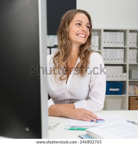 Sitting Happy Office Girl in White Long Sleeve Shirt, Leaning on the Table While Looking at Right Frame - stock photo