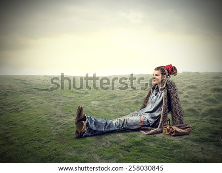 Sitting in a field  - stock photo