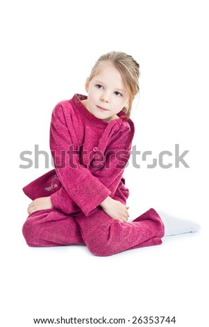 Sitting little girl in pirple dress - stock photo
