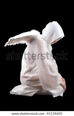 Sitting man dressed in white angel suit. Isolated on black - stock photo