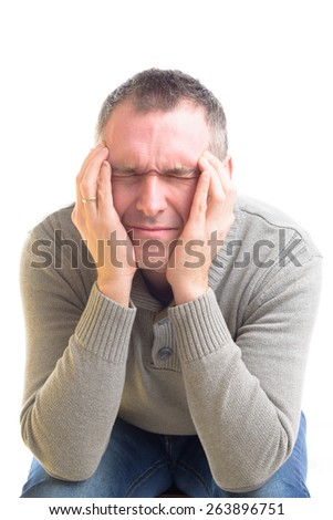 Sitting man with a headache over white background - stock photo